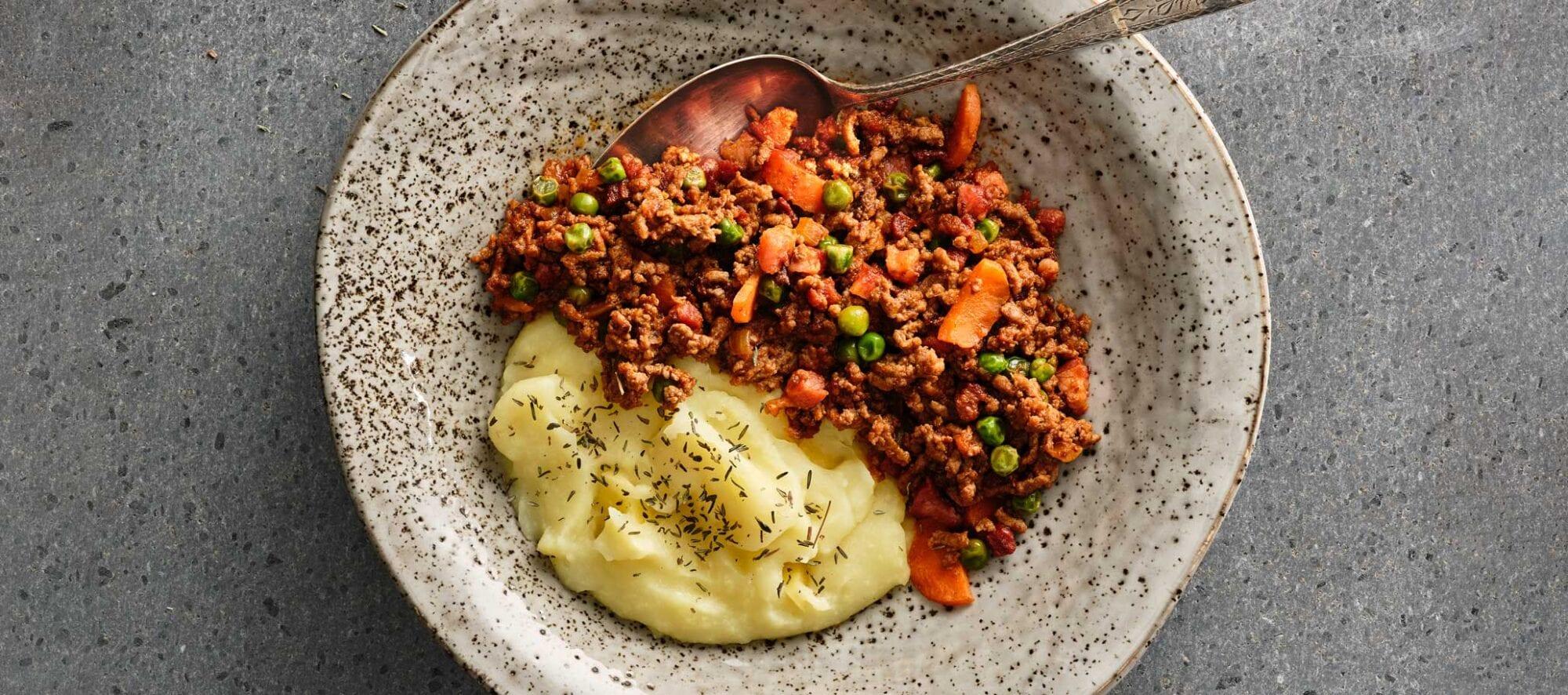 Millionboef med groentsager og kartoffelmos